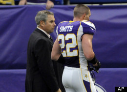 Minnesota Vikings safety Harrison Smith is escorted off the field during the first half of an NFL football game against the Tennessee Titans, Sunday, Oct. 7, 2012, in Minneapolis. Smith was ejected from the game after pushing an official who was trying to break up an on-field altercation.
