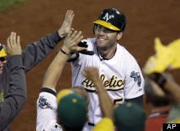 Oakland Athletics' Seth Smith celebrates his solo home run in the fifth inning of Game 3 of an American League division baseball series against the Detroit Tigers in Oakland, Calif., Tuesday, Oct. 9, 2012.