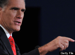 Republican presidential candidate Mitt Romney speaks during his debate with U.S. President Barack Obama at Magness Arena at the University of Denver in Denver, Colorado, October 3, 2012, moderated by Jim Lehrer (C) of the PBS NewsHour. (NICHOLAS KAMM/AFP/GettyImages)