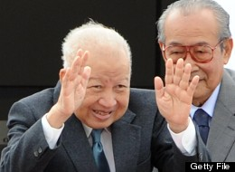 (FILES) Photo dated January 19, 2012 shows Cambodia's former king, Norodom Sihanouk (L) bidding farewell to government officials as he boards a plane before leaving to Beijing at Phnom Penh International airport. (TANG CHHIN SOTHY/AFP/GettyImages)
