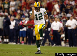 Aaron Rodgers  of the Green Bay Packers celebrates after a touchdown pass in the fourth quarter against the Houston Texans at Reliant Stadium on October 14, 2012 in Houston, Texas.
