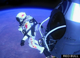 In this photo provided by Red Bull Stratos, skydiver Felix Baumgartner of Austria steps into the history books. In a giant leap from more than 24 miles up, the daredevil shattered the sound barrier Sunday while making the highest jump ever – a tumbling, death-defying plunge from a balloon to a safe landing in the New Mexico desert. (Red Bull)