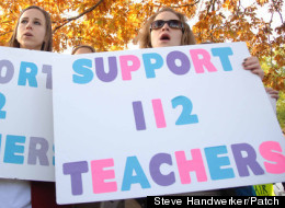 Teachers hit the picket lines in suburban Highland Park, Ill. Tuesday.