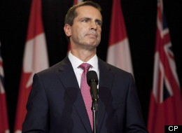 Ontario Premier Dalton McGuinty listens to a question as he speaks to the media at Queen's Park after announcing his resignation in Toronto on Monday, October 15, 2012. THE CANADIAN PRESS/Michelle Siu