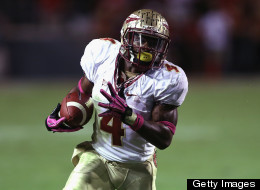 Chris Thompson of the Florida State Seminoles runs with the ball against the North Carolina State Wolfpack during their game at Carter-Finley Stadium on October 6, 2012 in Raleigh, North Carolina.