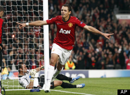 Manchester United's Javier Hernandez celebrates after he scores the third goal of the game for his side during their Champions League Group H soccer match against SC Braga at Old Trafford in Manchester, England, Tuesday Oct. 23, 2012.