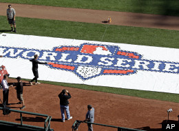 Workers paint a logo on the field at AT&T Park before workouts for baseball's World Series Tuesday, Oct. 23, 2012, in San Francisco. The Detroit Tigers play the San Francisco Giants in Game 1 on Wednesday, Oct. 24.
