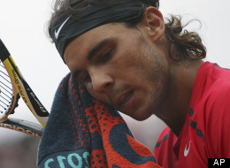 This June 10, 2012 file photo shows Rafael Nadal wiping his face as he plays Serbia's Novak Djokovic during their men's final match in the French Open tennis tournament at Roland Garros stadium in Paris. Nadal still has no timetable for his return from a knee injury.