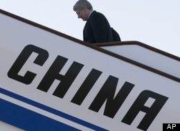 The federal government has come under heavy scrutiny from opposition parties and critics alike after Prime Minister Stephen Harper signed an investment treaty with China, formally known as a Foreign Investment Promotion and Protection Agreement (FIPA), while at the APEC Summit in Vladivostok, Russia, on Sept.9, 2012. (AP)