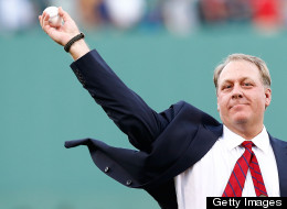 Former Boston Red Sox pitcher Curt Schilling #38 throws out the first pitch after being inducted into the Red Sox Hall of Fame prior to the game against the Minnesota Twins during the game on August 3, 2012 at Fenway Park in Boston, Massachusetts.