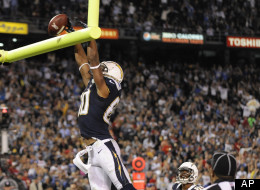 San Diego Chargers wide receiver Malcom Floyd celebrates his touchdown reception against the Kansas City Chiefs, tipping the ball over the crossbar during the second half of an NFL football game Thursday, Nov. 1, 2012, in San Diego.