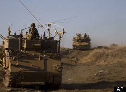 Israeli soldiers conduct a military exercise in the Israeli-controlled part of the Golan Heights, captured from neighboring Syria in the 1967 war, Wednesday, Sept. 19, 2012. The Israeli military on Wednesday conducted its largest snap drill in years as tensions with Iran over its nuclear program rise and civil war in neighboring Syria rages. (AP Photo/Ariel Schalit)