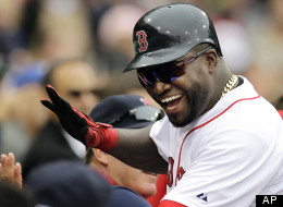 Boston Red Sox designated hitter David Ortiz celebrates as he returns to the dugout after scoring on a single by Will Middlebrooks in the fifth inning of a baseball game against the Seattle Mariners at Fenway Park in Boston, Tuesday, May 15, 2012. (