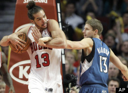Chicago Bulls center Joakim Noah, left, battles for a rebound against Minnesota Timberwolves guard Luke Ridnour during the second half of an NBA basketball game in Chicago on Saturday, Nov. 10, 2012. The Bulls won 87-80. Noah had 17 points and seven rebounds. (AP Photo/Nam Y. Huh)