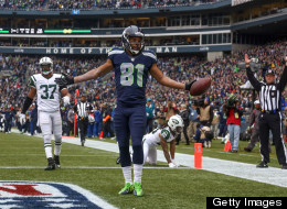 Wide receiver Golden Tate of the Seattle Seahawks celebrates after scoring a touchdown against the New York Jets at CenturyLink Field on November 11, 2012 in Seattle, Washington.
