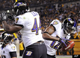 Baltimore Ravens' Jacoby Jones and Vonta Leach celebrate after Jones returned a punt for a touchdown in the first quarter of an NFL football game, Sunday, Nov. 18, 2012, in Pittsburgh.