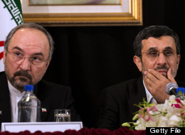 Iran's President Mahmoud Ahmadinejad (R) speaks at a news conference as Iran's Ambassador to the United Nations Mohammad Khazaee listens on September 26, 2012 in New York. (DON EMMERT/AFP/GettyImages)