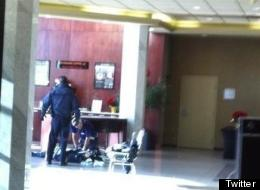 An eyewitness photo of the scene inside a Burnaby hotel after a deadly shooting. (Twitter @timothyw_only1)