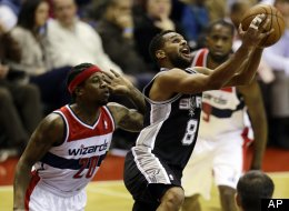San Antonio Spurs guard Patty Mills, from Australia, shoots as he guarded by Washington Wizards forward Cartier Martin in the second half of an NBA basketball game Monday, Nov. 26, 2012, in Washington. The Spurs won 118-92.
