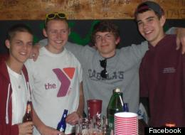 Griffin Healey (center, gray shirt) suffered head injuries.