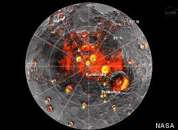 NASA images showing Mercury's north polar region. The red areas are permanently shadowed, and the yellow are radar bright spots that are now thought to be deposits of water ice.