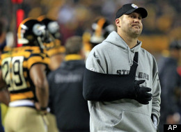 Pittsburgh Steelers quarterback Ben Roethlisberger looks up at the video board as he stands on the sidelines wearing a sling on his injured arm during the second quarter of an NFL football game against the Baltimore Ravens, Sunday, Nov. 18, 2012, in Pittsburgh.