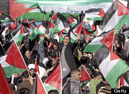 Palestinian flags are waved as crowds wait to hear an address by Palestinian president Mahmud Abbas.