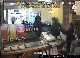 Georgia police are seeking an armed robber who shot two people during a deli robbery in Atlanta.