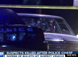 Still from video of the aftermath of a shooting that left two dead in Cleveland Nov. 29 shows the suspects' car riddled with bullet holes. Police say 137 shots were fired.