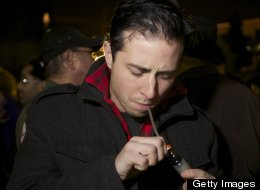 Jared Cruver of Snohomish, Wash., smokes marijuana from a mini water pipe shortly after a law legalizing the recreational use of marijuana took effect on December 6, 2012 in Seattle, Washington. Voters approved an initiative to decriminalize the recreational use of marijuana making it one of the first states to do so. (Photo by Stephen Brashear/Getty Images)