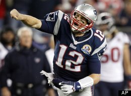 New England Patriots quarterback Tom Brady (12) reacts after running for yardage against the Houston Texans during the third quarter of an NFL football game in Foxborough, Mass., Monday, Dec. 10, 2012. (AP Photo/Stephan Savoia)