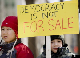 Left-leaning advocacy group the Council of Canadians stands to gain nothing from a Federal Court case into allegations of voter-suppression tactics, other than to ensure that democracy is upheld, says a lawyer for eight voters challenging the results in six ridings. Pierre-Andre (7), left, and Ernest (5) Auclair attend a demonstration in Montreal, Sunday, March 11, 2012, protesting the 'Robocall', election fraud scandal. (CP)
