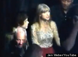 Taylor Swift smooches Harry Styles backstage at Z100's Jingle Ball in NYC.