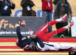 Arizona's Terrance Miller comes down with a touchdown catch in the end zone in front of Nevada's Bryson Keeton to tie the game in the closing seconds of the fourth quarter of New Mexico Bowl NCAA college football game in Albuquerque, N.M., Saturday, Dec. 15, 2012. (AP Photo/Eric Draper)
