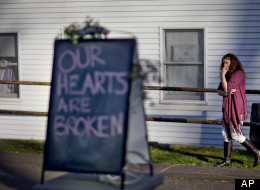 Shop owner Tamara Doherty, paces outside her store just down the road from Sandy Hook Elementary School, Saturday, Dec. 15, 2012, in Newtown, Conn.