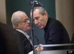 Vito Rizzuto, right, reputed head of the Montreal Mafia, speaks with his attorney Jean Salois after his hearing in Montreal on Feb. 6, 2004. A low-key mob war being waged in Quebec won't rattle this province because Ontario is the economic engine fuelling the battle, sources say.  (THE CANADIAN PRESS/Ryan Remiorz)