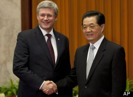 Canadian Prime Minister Stephen Harper meets with Chinese President Hu Jintao at the Great Hall of the People in Beijing, Thursday, Feb.9, 2012. (AP Photo/The Canadian Press, Adrian Wyld)