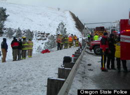 Emergency officials stand next to I-84 near Pendleton, Ore. at the scene of a fatal bus crash that killed nine people. (Oregon State Police)