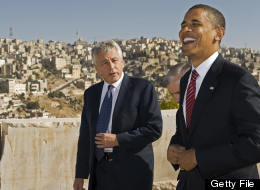 Then-U.S. Democratic presidental candidate Barack Obama (R) shares a laugh with then-U.S.-Senator Chuck Hagel R-Neb., as they tour the Citadel on July 22 2008, with the hillsides of Amman in the background. (PAUL J. RICHARDS/AFP/Getty Images)