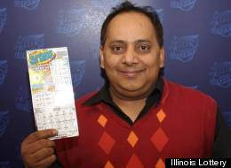Urooj Kahn poses with his winning lottery ticket. A day after claiming his prize, Kahn died in what was later called a homicide by the Cook County Medical Examiner's office. (Illinois Lottery)