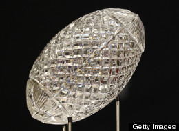 The Coaches Trophy, awarded to one college per year, encourages a student-subsidized publicity push, critics argue.