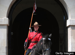 A female member of the Royal Canadian Mounted Police (RCMP) stands guard at Horse Guards Parade in central London, on May 23, 2012, as the RCMP take part in the 'Changing of the Guard' ceremony. Their participation is part of the Queen's Diamond Jubilee celebrations and will also feature women for the first time. (CARL COURT/AFP/GettyImages)