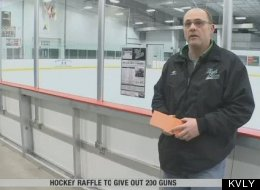 Cal Helgeson of the West Fargo Hockey Association holds the list of weapons that will go to raffle winners.