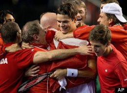 Canada's Milos Raonic is mobbed by teammates after defeating Spain's Guillermo Garcia-Lopez during a Davis Cup tennis world group first-round tie singles match in Vancouver on Sunday. (AP Photo/The Canadian Press/Darryl Dyck)