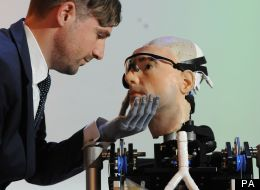 Bertolt Meyer looks at a 'bionic man' modeled on himself at the Science Museum in London.