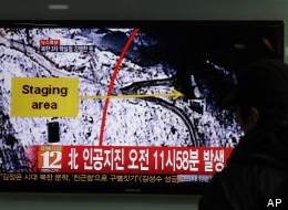 A South Korean passenger watches TV news reporting an earthquake in North Korea, at the Seoul train station in Seoul, South Korea, Tuesday, Feb. 12, 2013. (AP Photo/Lee Jin-man)