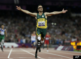 In this Saturday, Sept. 8, 2012 file photo, South Africa's Oscar Pistorius wins gold in the men's 400-meter T44 final at the 2012 Paralympics, in London. Pistorius has been arrested after a 30-year-old woman was shot dead at his home in South Africa. (AP Photo/Kirsty Wigglesworth, File)