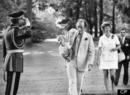 Pierre Trudeau is saluted by RCMP Officer as he carries son Justin to Rideau Hall in 1973. Justin Trudeau teared up when he was presented with a framed copy while visiting Loyalist College. The Canadian Press/ Peter Bregg