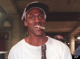 Chicago Bulls' Michael Jordan leaves the United Center with champagne and a cigar Sunday night, June 16, 1996, in Chicago, after the Bulls beat the Seattle SuperSonics 87-75 to win their fourth NBA Championship. (AP Photo/Frank Polich)