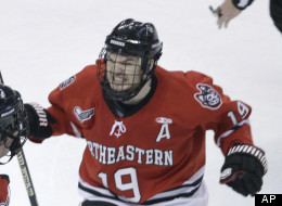 Northeastern's Wade MacLeod, right, celebrates a goal by Brodie Reed, left, against Boston College during the first period of the championship college hockey game of the Beanpot tournament in Boston, Monday, Feb. 14, 2011. (AP Photo/Charles Krupa)